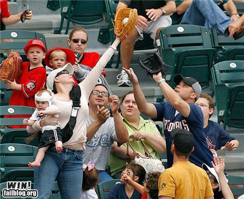 Mom with baby (in helmet!) catches fly ball in the stands