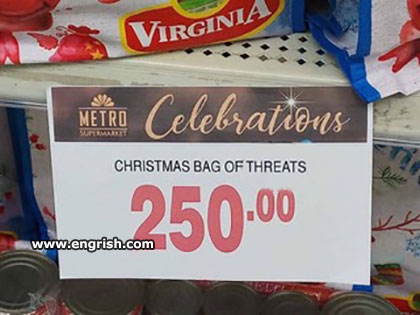 "A sign on a shelf reading ""CHRISTMAS BAG OF THREATS: 250.00"""